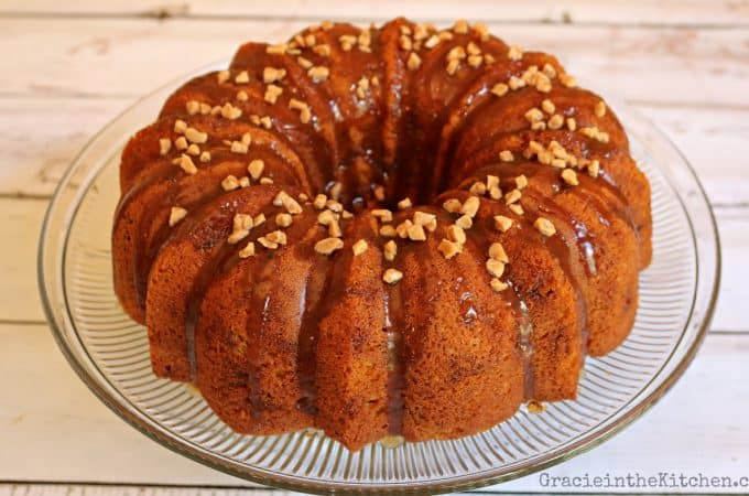 Easy, delicious Pumpkin Spice Bundt Cake with Toffee Bits and Caramel Sauce